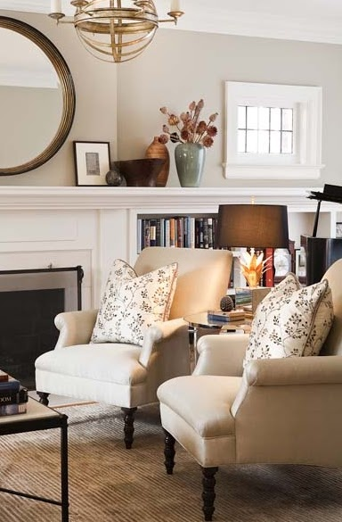 Love the mantel piece that connects the bookcase & fireplace. And I love the big round mirror over the fireplace. From C.B.I.D. Home Decor & Design