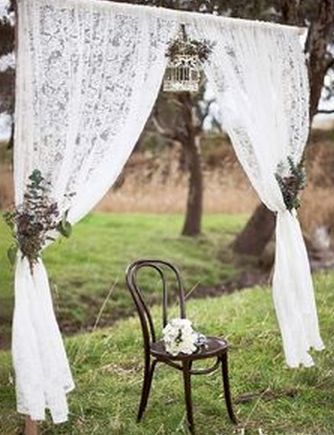 AWESOME WEDDING PHOTO PROPS  - Old Chair and homemade fabric archway for a rustic outdoor wedding  Want more wedding photo prop ideas? http://tailoredfitfilms.com/awesome-wedding-photo-props/