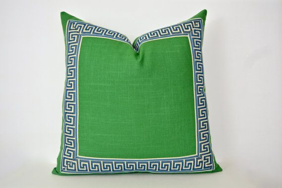 Green pillow with Greek key trim. Medium-weight Kelly green linen slub fabric is trimmed with navy and off-white Greek key around the