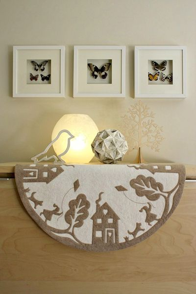 Paper cut work table mat - quite like this. Simple, elegant and a bit whimsical