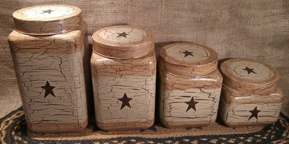 Welcome! Up for sale, primitive, crackle glass canisters, set of 4. I painted the set brown, crackled in tan, added brown stars, antiqued and sealed with matte sealer. Glass canisters with metal screw on lids. Set is new. Ask me about custom orders. Included: 4 glass canisters