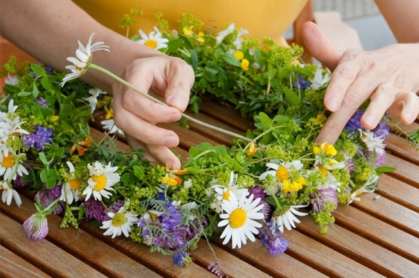 midsummer's day: 23rd of june- latvian tradition making flower crowns, eating cheeze, drinking beer and jumping over fires