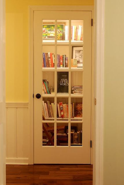 Turn a closet into a library and add a French door. I love this idea!