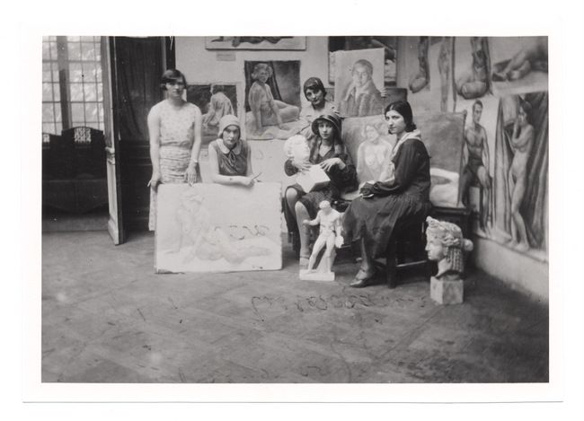 Warszawa, 1930. Five art students, pose with their paintings, drawings, and sculptures, which are on exhibit.