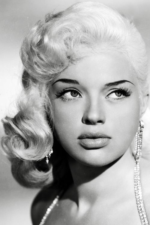 Diana Dors (1957)  I'm stunned by how modern she looks....the eyebrows, lashes, full lips and big hair!   She was certainly a stunner :-)