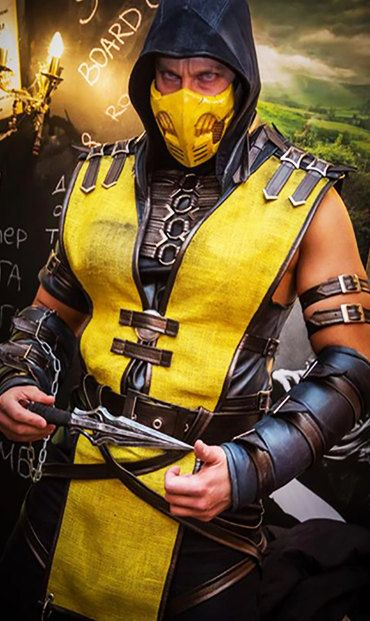 Super authentic Mortal Combat Scorpion costume   Scorpion Costume from the Mortal Kombat video game - can be created in any size, both for men and boys. It features a sleeveless black leather vest, linen pants, tabard with leather belts and hood, metallic decorations and matching wristbands with belts. The weapon is not included in the costume. The price is only for the costume. The mask is not included…