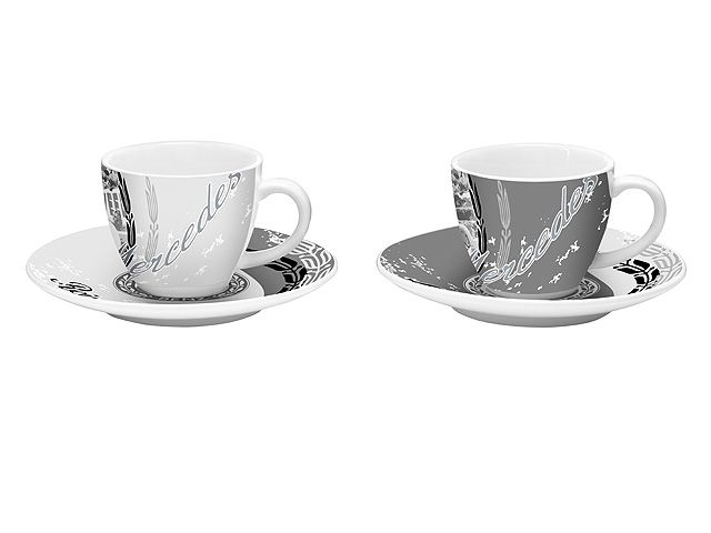 Part number:     B67995249  Indulgence and design combined to perfection: these espresso cups are decorated with a black and white print of motor racing motifs,  showing Reims in 1954 and Lyon in 1914. A vintage logo features on the saucers.  The 2-cup set is packaged in a decorative gift box and was designed by Ritzenhoff for Mercedes-Benz.