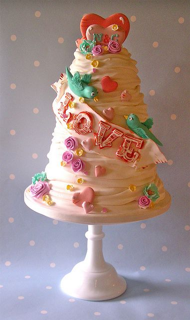 Summer of love wedding cake, via Flickr.