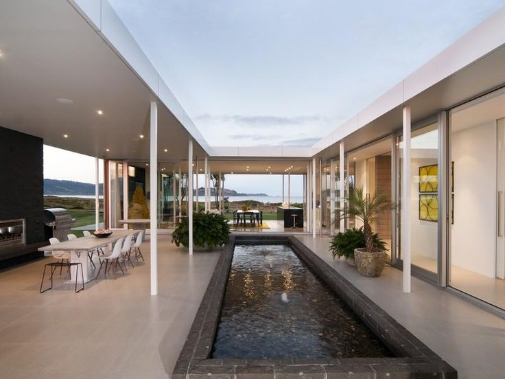 Exquisite glass cladded haven on omaha beach covered for Beach house builders new zealand