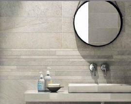 Avant Bone 30x60 - A white/ grey stone effect wall and floor tile.