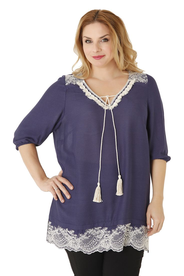 Denim style top, decorated with lace details and a tassel with fringes at the V neckline. A fashionable choice for a unique look!