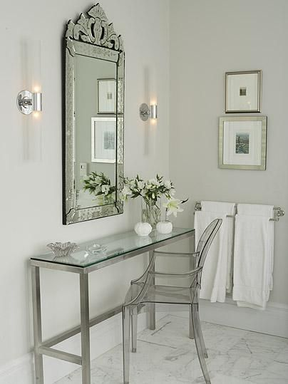 bathrooms - Farrow & Ball - Mirage Gray - Ghost Chair gray Phillipe Stark ghost chair glass top console table ornate mirror modern sconces white carrara marble tiles floors gray walls paint color bathroom