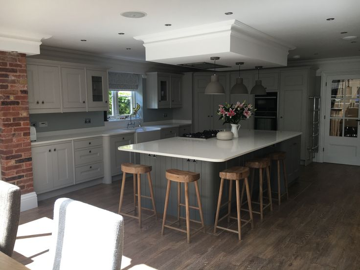 Grey bespoke kitchen, cornforth white and plummet paint, Cox and Cox wooden stools, honey oak van gogh flooring
