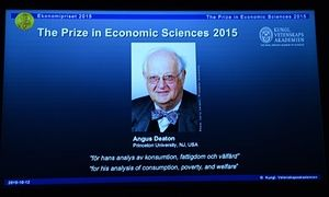 Nobel Prize in Economic Sciences<br>epa04974835 A picture of Professor Angus Deaton, winner of the 2015 Sveriges Riksbank Prize in Economic Sciences in Memory of Alfred Nobel is seen on a screen as the Permanent Secretary for the Royal Swedish Academy of Sciences addresses a press conference to announce the winner of the prize at the Royal Swedish Academy of Science, in Stockholm, Sweden, 12 Oc tober 2015. EPA/MAJA SUSLIN/TT SWEDEN OUT