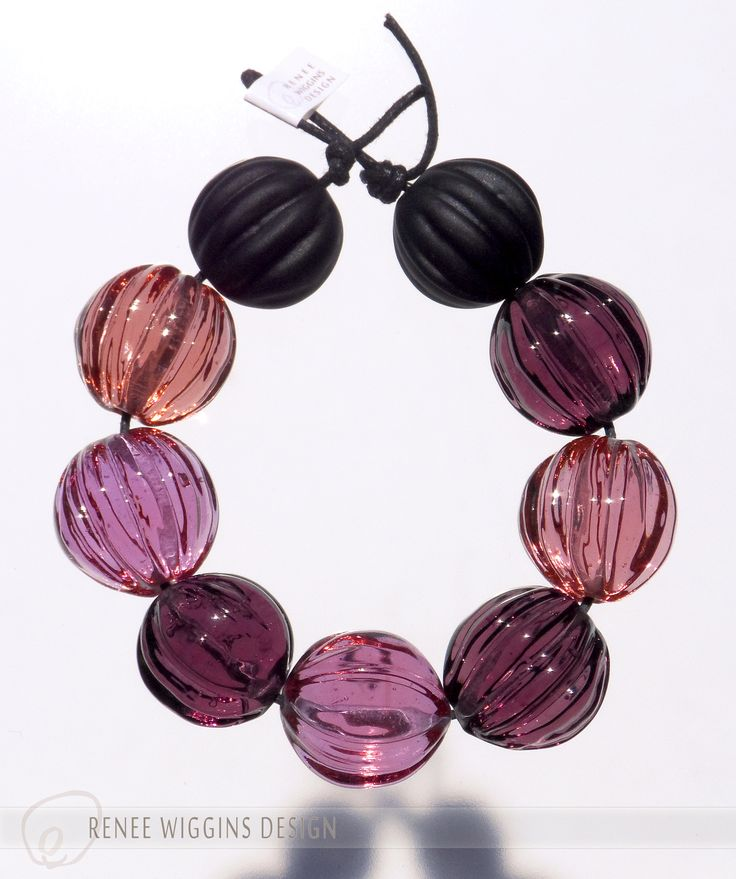 """Pinky-purples & etched matte black compliment this set of seed pod/walnut/melon lampworked glass beads. 5/8"""" diameter. Elegant ~ tribal ~ organic. RWD 2015"""