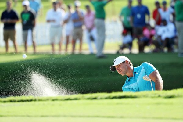 Brooks Koepka of the United States plays a shot from a bunker on the 15th hole during the third round of the TOUR Championship at East Lake Golf Club on September 23, 2017 in Atlanta, Georgia.