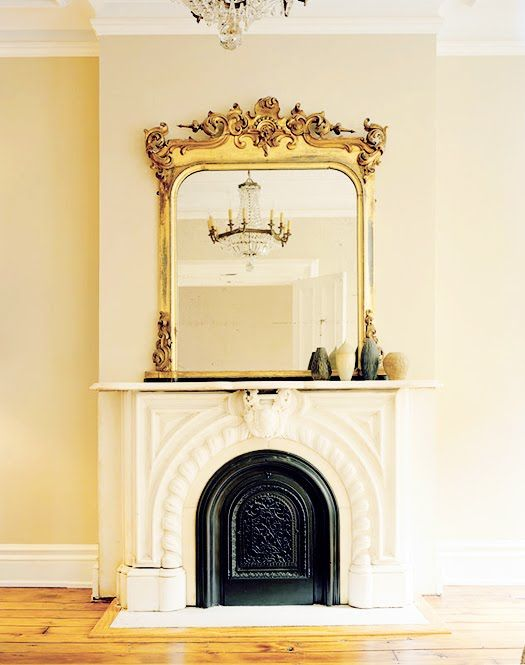 gold mirror above fireplace