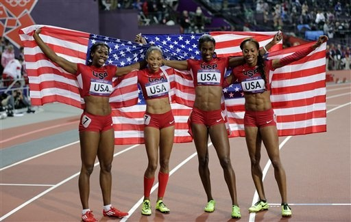 Day 15 - From left, United States' Francena McCorory, United States' Allyson Felix, United States' Deedee Trotter and United States' Sanya Richards-Ross celebrate winning gold in the women's 4x400-meter relay final during the athletics in the Olympic Stadium at the 2012 Summer Olympics, London, Saturday, Aug. 11, 2012. (AP Photo/David J. Phillip)