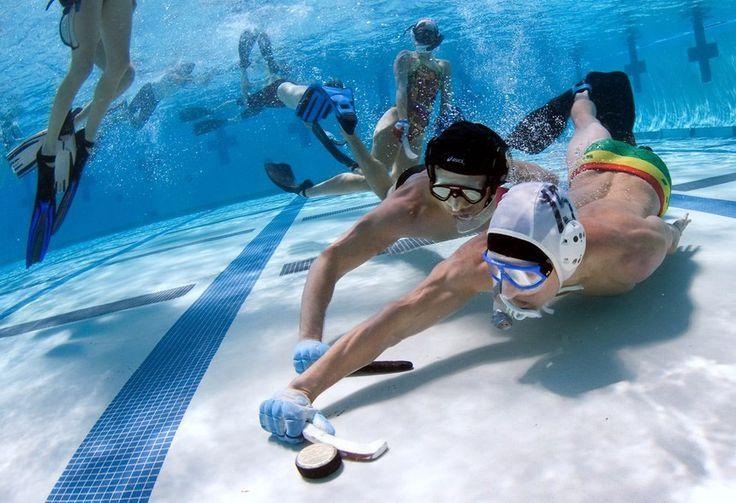 SOUND: http://www.ruspeach.com/en/news/13026/     Подводный хоккей был изобретён англичанами в 1954 году. В подводный хоккей играют две команды, в составе каждой из которых 6 человек. В игре нужно при помощи 30-сантиметровой клюшки забить в ворота соперника шайбу. В 2004 году было принято проводить чемпионат Мира по этому спорту.    The underwater hockey was invented by British in 1954. In underwater hockey is played by two teams, each of which consists of 6 people. In game i