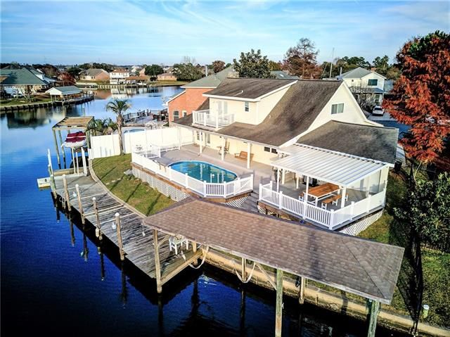 Enjoy gorgeous views w/ this meticulously kept, Acadian