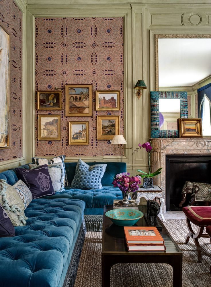 bohemian abode - adore the pink wallpaper and the peacock blue velvet corner sofa. There so much going on in this sitting room but it works.