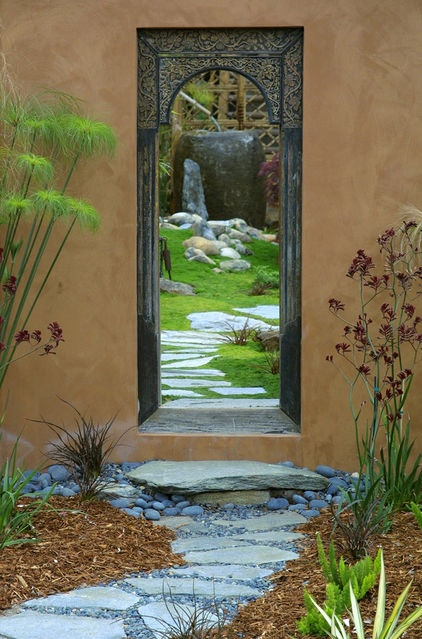 "This ""humble"" door is used to present the viewer with a snapshot of the water element within the walled garden. The come-hither path draws the eye to the garden wall, through the humble door and into the garden, leading to we know not where."