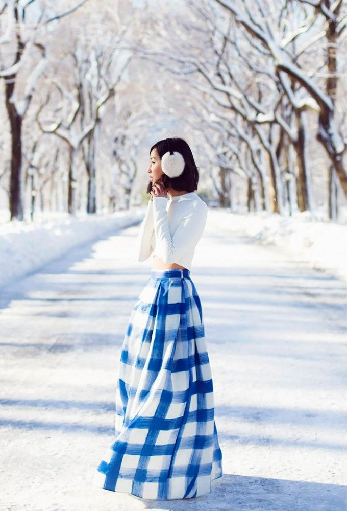 Winter vibes are radiating in this cool-toned outfit with a white crop and blue A-line maxi skirt.