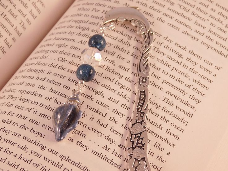 A personal favorite from my Etsy shop https://www.etsy.com/listing/554825854/nautical-bookmark-dolphin-and-seashell