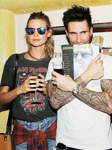 Behati Prinsloo flaunted her vintage rocker style by sporting Clubmaster sunnies with blue flash lenses, a chain necklace and a cool old-school band tee!