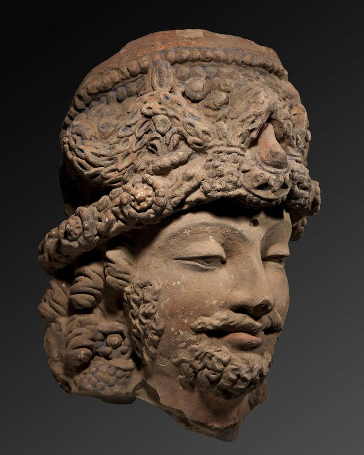 Head of a Bodhisattva Afghanistan 3rd-4th century AD terracotta with pigments height: 48cm