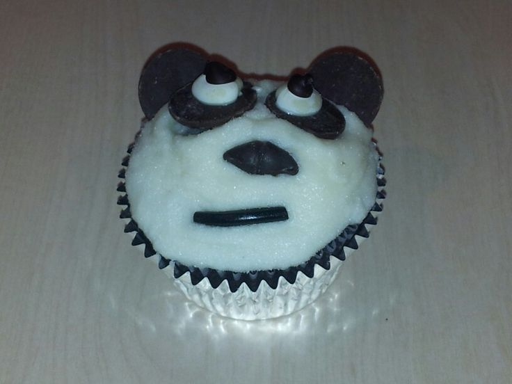 Panda cupcake for SPCA cupcake day 2013. Chocolate cupcake, vanilla butter cream, sugar sand, chocolate and liquorice decorations.