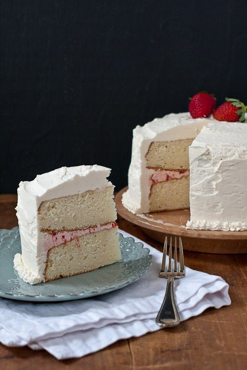 white cake with strawberry filling and strawberry-vanilla buttercream frosting