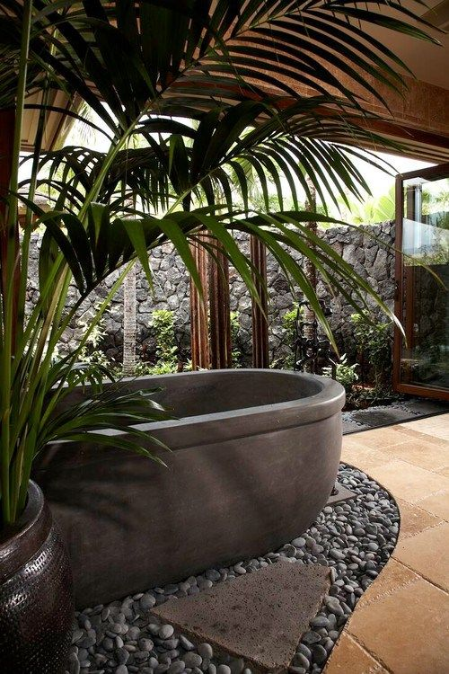 This bath! Love the use of lava rock wall. Hawaiian Home full of delicious style…