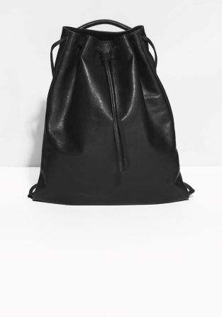 Lined in cotton twill for durability and added structure, this clean yet sophisticated backpack is cast in smooth Italian leather. The drawstring closure adds a free-spirited vibe while the double shoulder straps and top handle provide versatility and comfort.