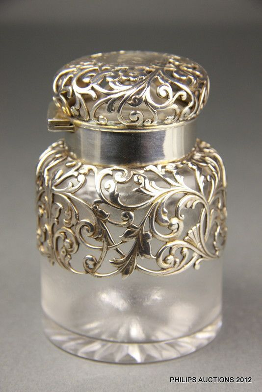 An antique American sterling silver-mounted glass scent bottle,… - Scent Bottles - Costume & Dressing Accessories - Carter's Price Guide to Antiques and Collectables #SterlingSilverVases