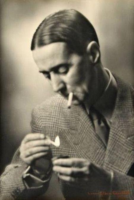 Laure Albin-Guillot- Daniel Rops (1901-1965 Ecrivain et historien français, allumant une cigarette, 1950