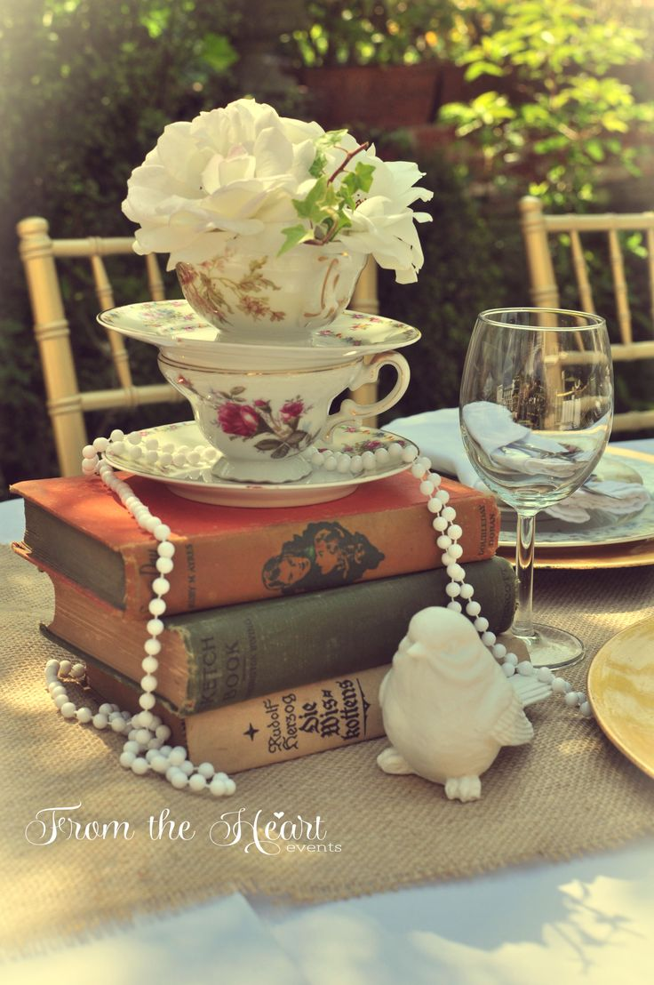 Tea cup centerpiece with vintage books and pearls