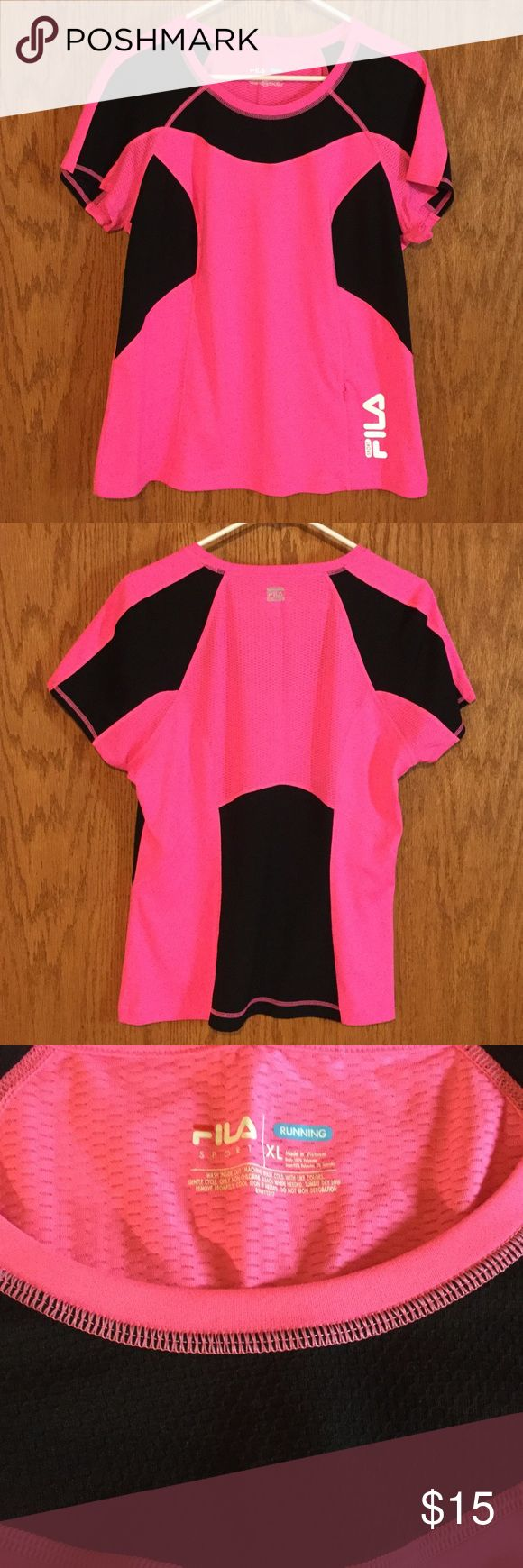 Fila Sport Running Top Fila Sport Cap Sleeve Running Top in Hot Pink and Black.  Zipper storage pocket on left front bottom.  Meshing in upper back and armpits of top.  XL.  Made in Vietnam of 100% Polyester.  Washer and Dryer safe.  Only worn once.  Very clean. Fila Tops