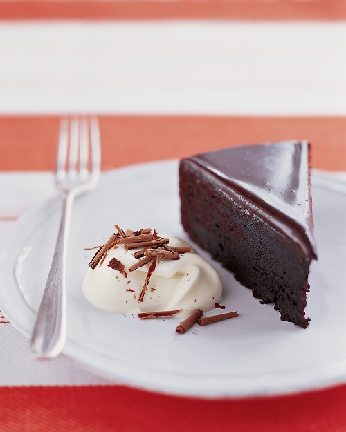 Glazed Chocolate Cake Recipe - Martha Stewart Recipes - Very easy to make and looks really impressive.  Intense semi sweet chocolate flavor.  Best with whipped cream or ice cream.  Makes a wonderful looking cake and is delicious!