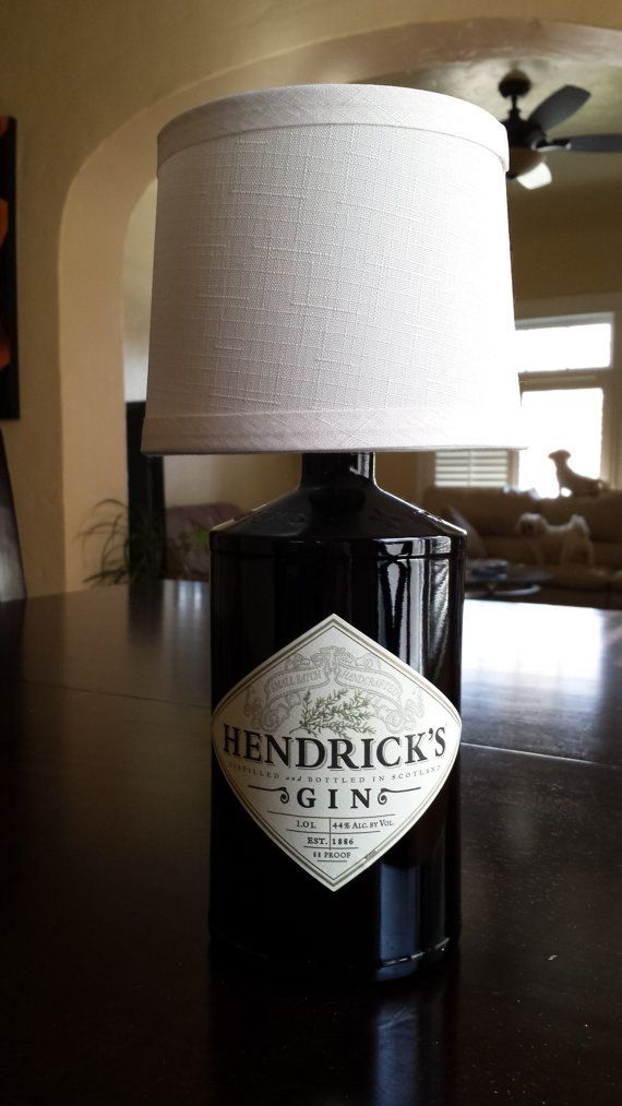 Handmade LED Hendricks Gin Liquor Bottle Lamp Out of all the bottles Ive been upcycling, I absolutely LOVE the shape and size of the Hendricks Gin bottle. The little grips built-in on the side to the solid black color of the glass just makes a sweet-looking lamp! Includes: -25 or 40 Watt LED Bulb (pricing varies) -Rinsed, Cleaned and Prepped Glass Bottle -Off-White Drum Clip-On Lamp Shade (5.5x4.75) -Six Foot Long Cord w/ ON&OFF Switch -Black Rubber Grommet -Black Felt Bottom…