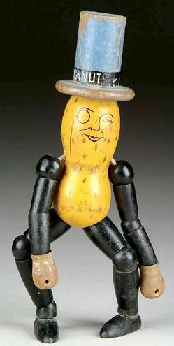 Vintage 1930's Mr Peanut wooden toy.  He looks like he's had one too many...
