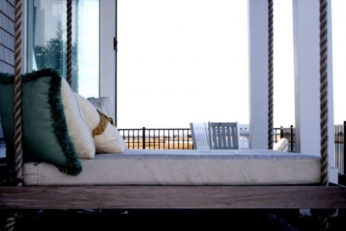 Oooh I want a swinging day bed on my patio. I could curl up like a cat and sleep there all afternoon!