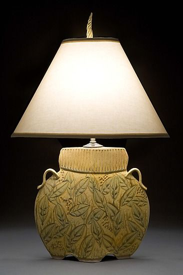 Arts and crafts lamp in gold ceramic table lamp created by jim and shirl