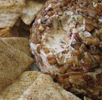 Gouda and Sun-Dried Tomato Cheese Ball, this recipe is so good I made it for work with a couple slight variations. I mixed the cheeses in my mixer and i put the sun dried tomatoes in a food processor until minced.