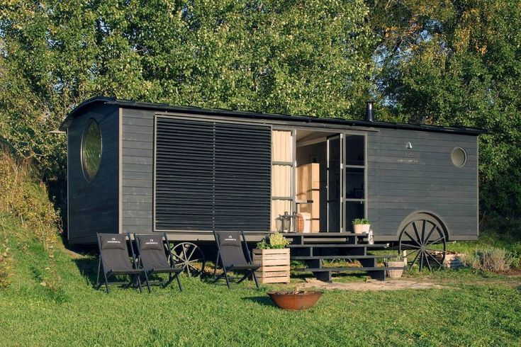 A modern version of the traditional wagon dwelling. It has a full kitchen, 3-piece bath and built-in bed in 258 sq ft. | www.facebook.com/Sm...