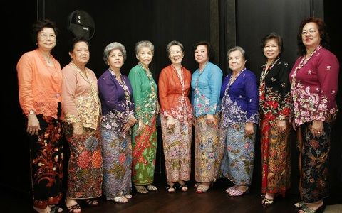 Wear the traditional clothing - Kebaya. A Kebaya is a traditional blouse-dress combination worn by women in Indonesia, Malaysia, Brunei, Burma, Singapore, southern Thailand. It is sometimes made from sheer material and usually worn with a sarong or batik kain panjang, or other traditional woven garment such as ikat, songket with a colorful motif.