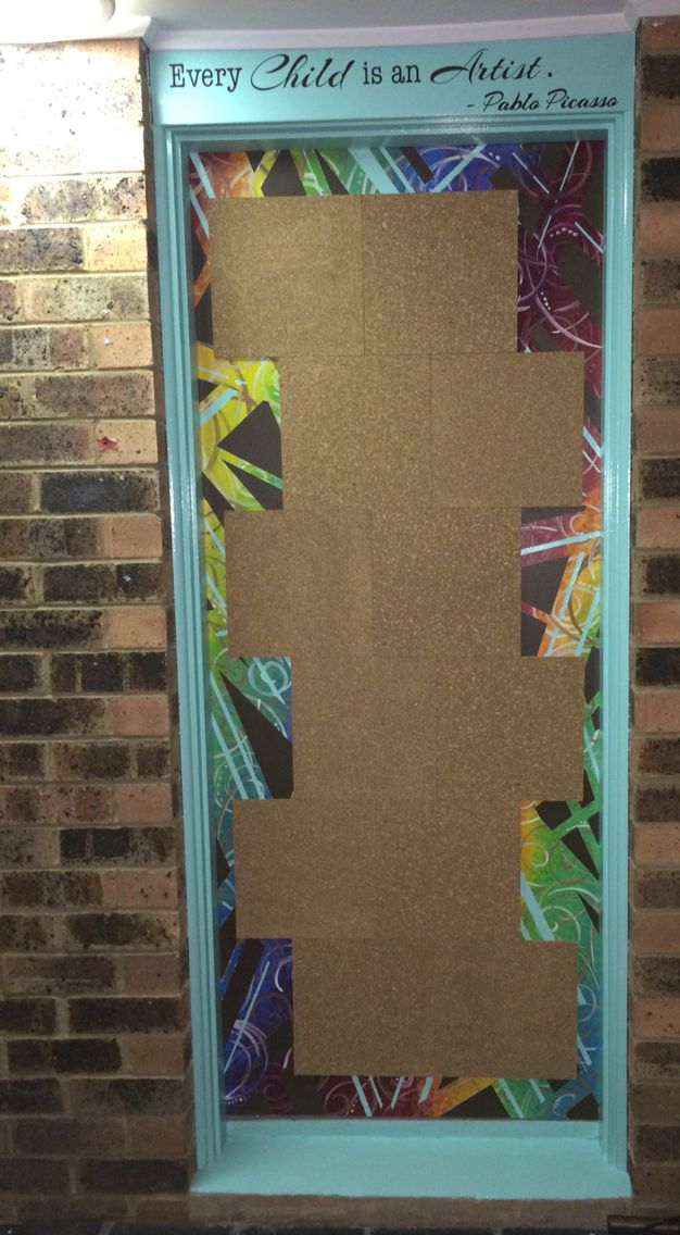 Converted the boring and ugly laundry door to the rumpus into a corkboard display area for the kids' artwork!