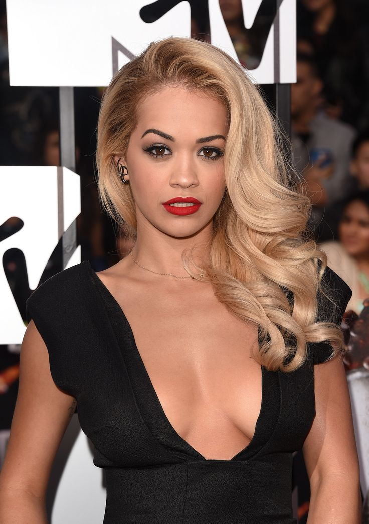 Va-va-voom! Rita turned up the sizzle with a classic Hollywood look comprising sculpted waves, arched brows, and matte red lips.