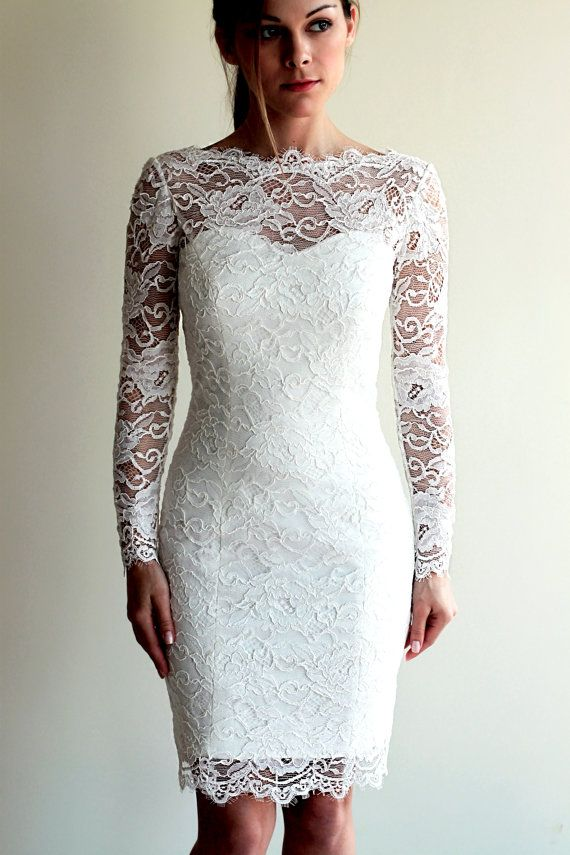 Short lace wedding dress with see-through neckline and back made in corded French lace  The dress is made in European atelier and is tailored