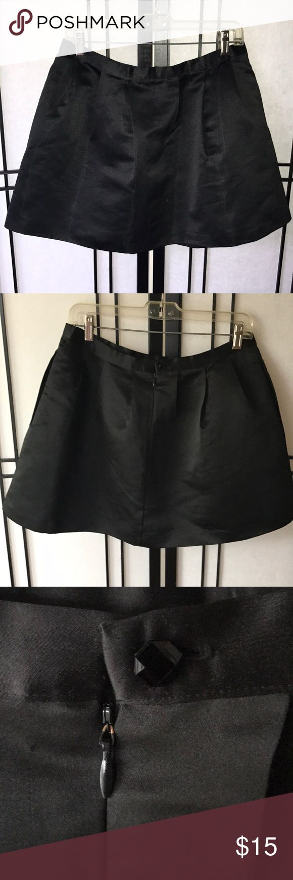 """Black silk skaters skirt from Forever 21 Beautiful Black silk skaters skirt from Forever 21. Love this too death but the hubs thinks it's too short. Bummer! 151/2"""" in length. Fully lined. Forever 21 Skirts Mini"""